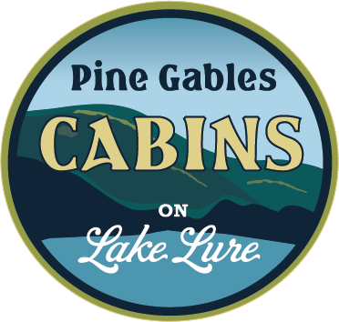... Cabins On Beautiful Lake Lure. Pine Gables Logo